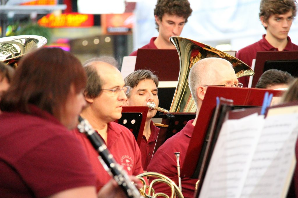 Queensland Wind and Brass plaing different brass instruments